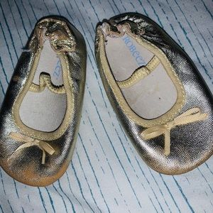 Baby's sparkly gold Robeez soft sole ballet flats